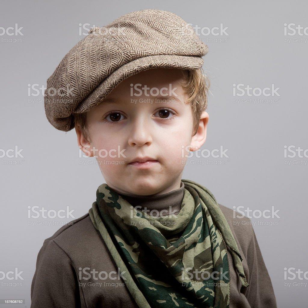 Portrait of little scout boy wearing flat newsboy cap stock photo