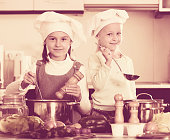Portrait of little sisters at kitchen