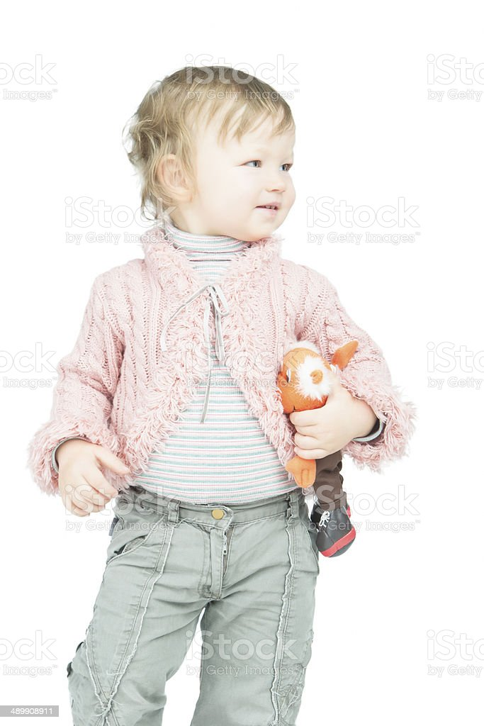 Portrait of little smiling toddler with toy stock photo