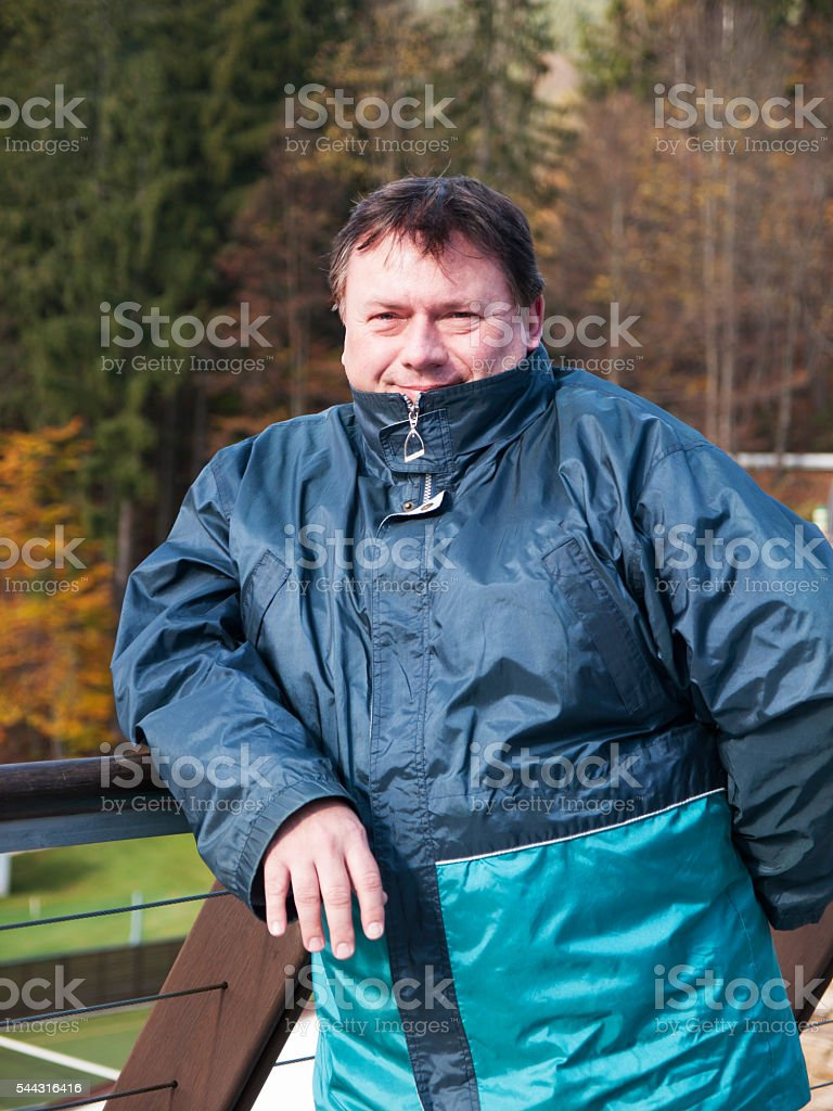 Portrait of lonely satisfied mature man stock photo
