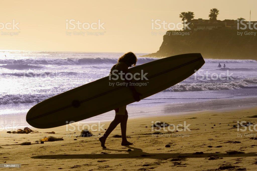 Portrait of Long Board Surfer on Beach royalty-free stock photo