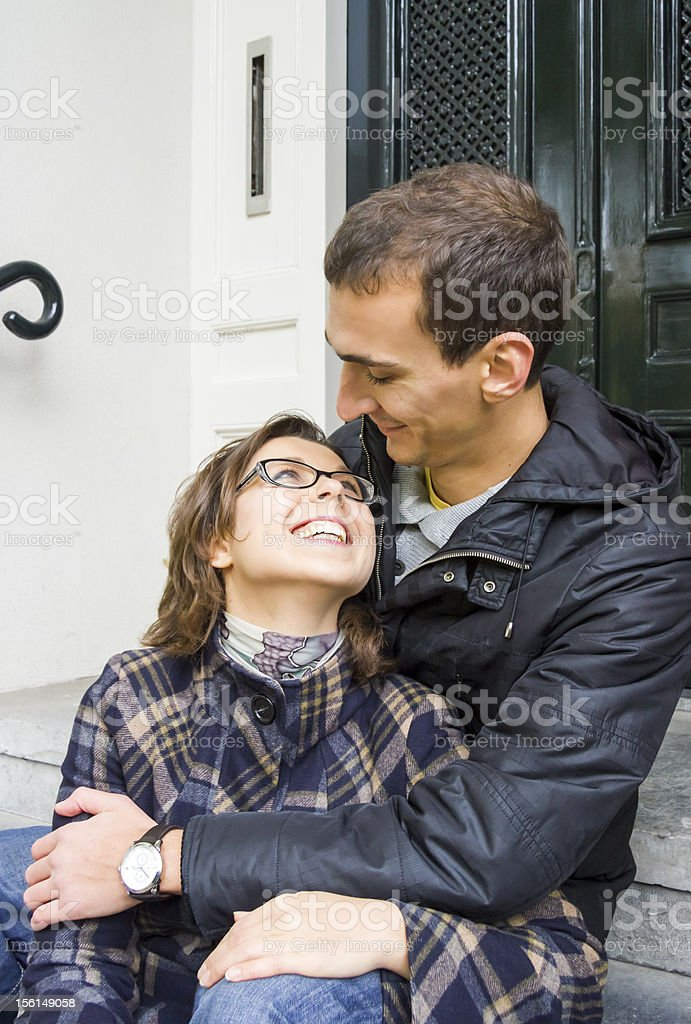Portrait of love couple embracing outdoor looking happy royalty-free stock photo