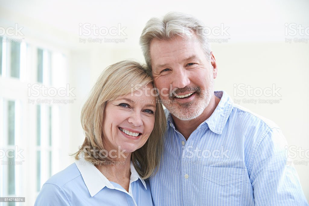 Portrait Of Loving Mature Couple At Home stock photo