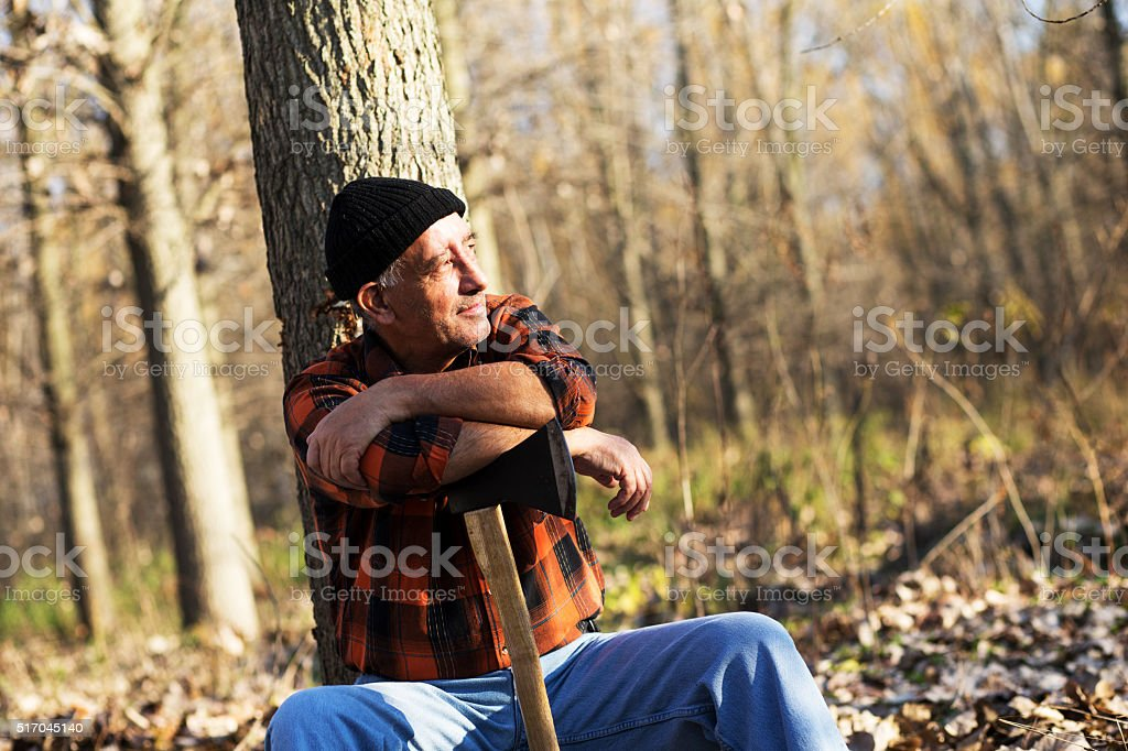 Portrait of lumberjack in nature stock photo