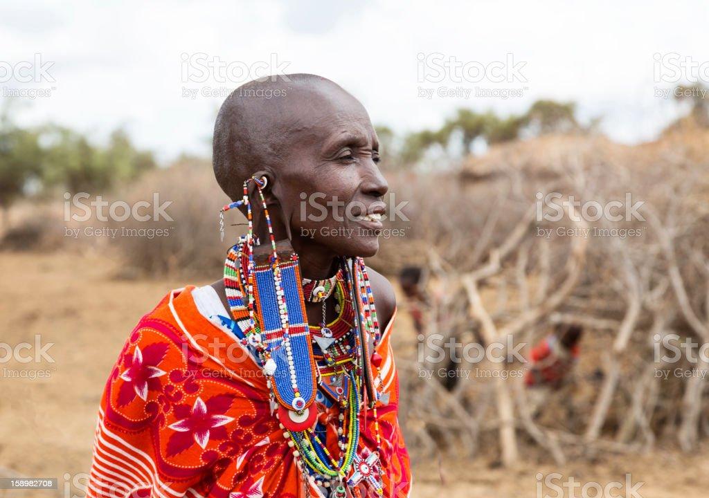 Portrait of Maasai woman outside village. stock photo