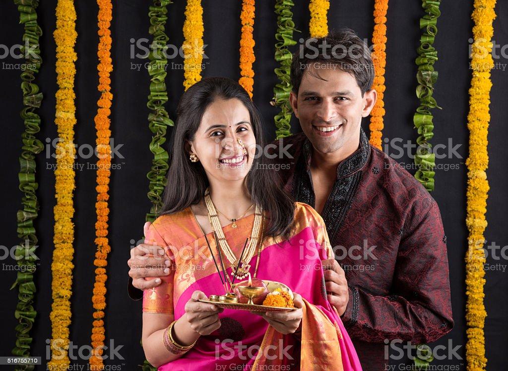 Portrait of Maharashtrian couple holding a puja thali stock photo