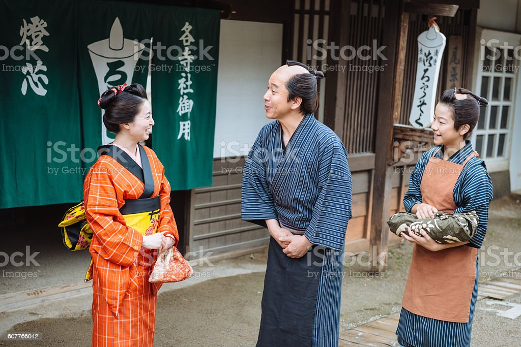Portrait of maiko and peasants in traditional Japanese village stock photo