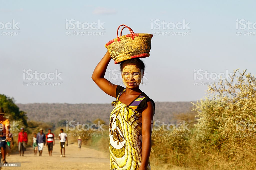 Portrait of malagasy woman with tradytional mask on the face stock photo