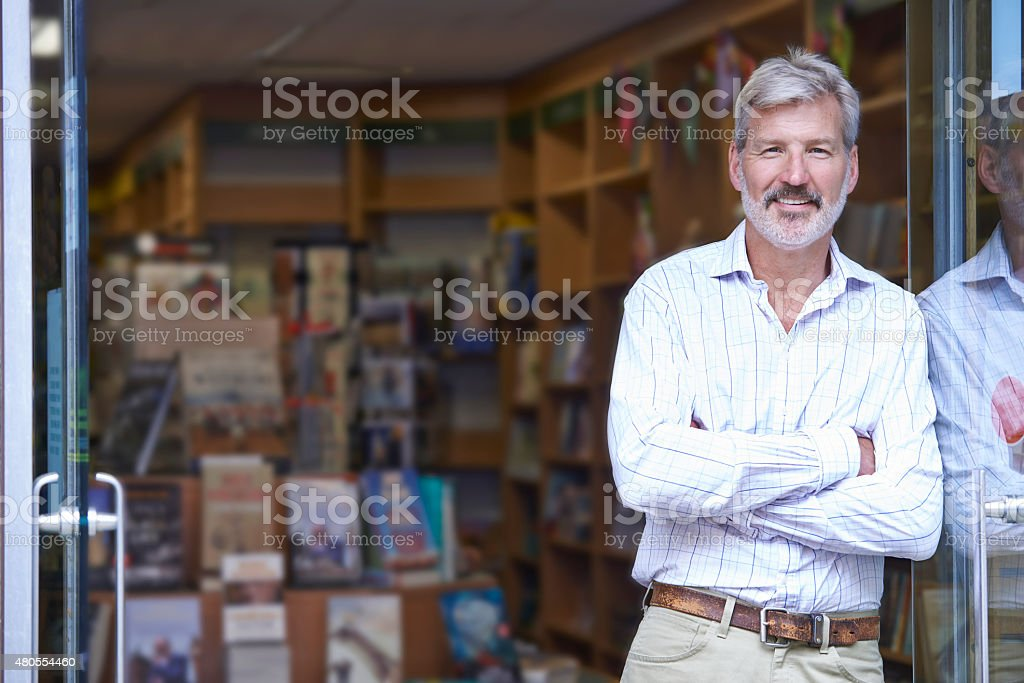Portrait Of Male Bookshop Owner Outside Store stock photo
