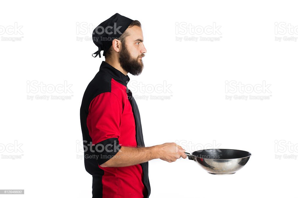 Portrait Of Male Chef Holding Pan stock photo