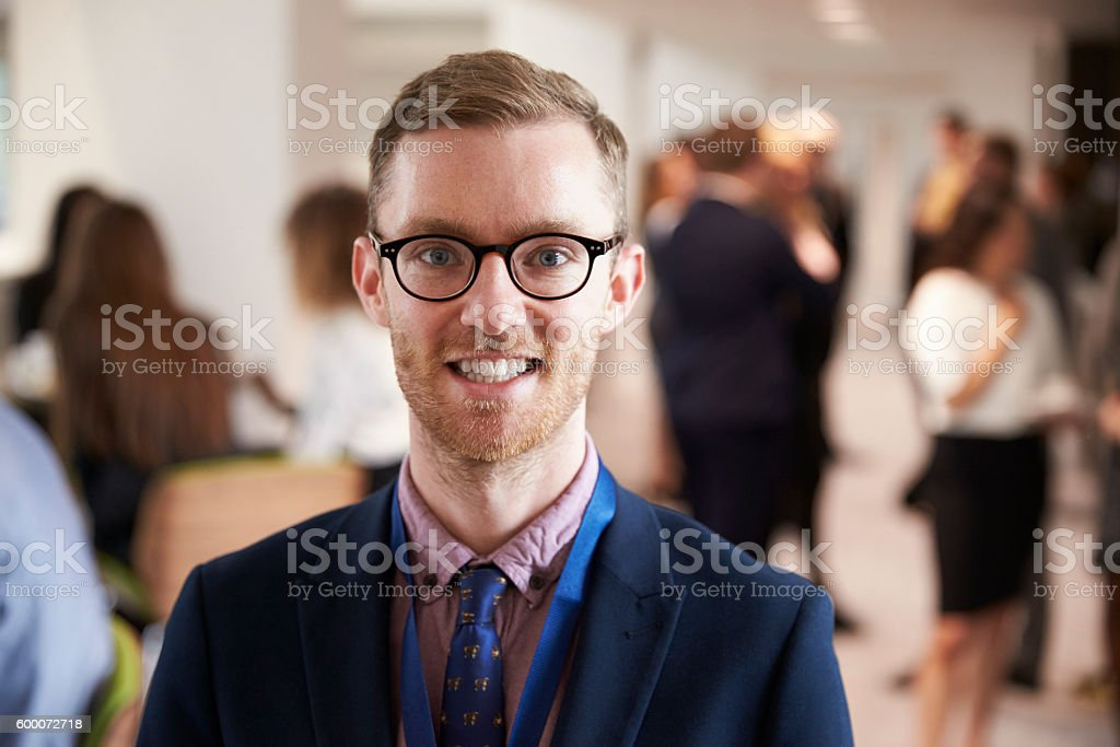 Portrait Of Male Delegate During Break At Conference stock photo