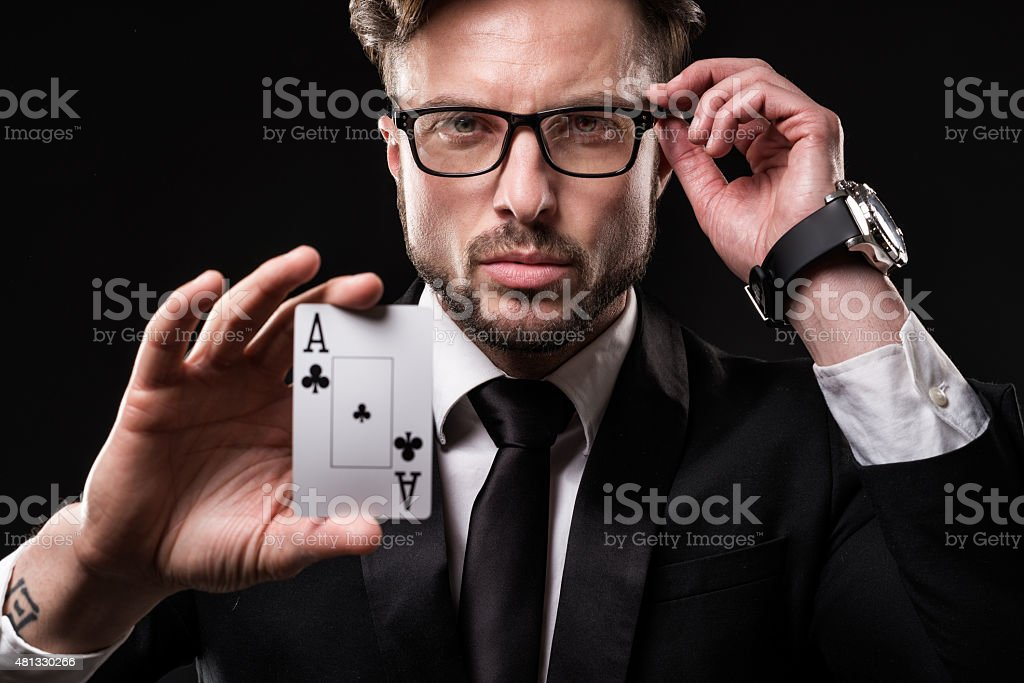 Portrait of male gambler stock photo