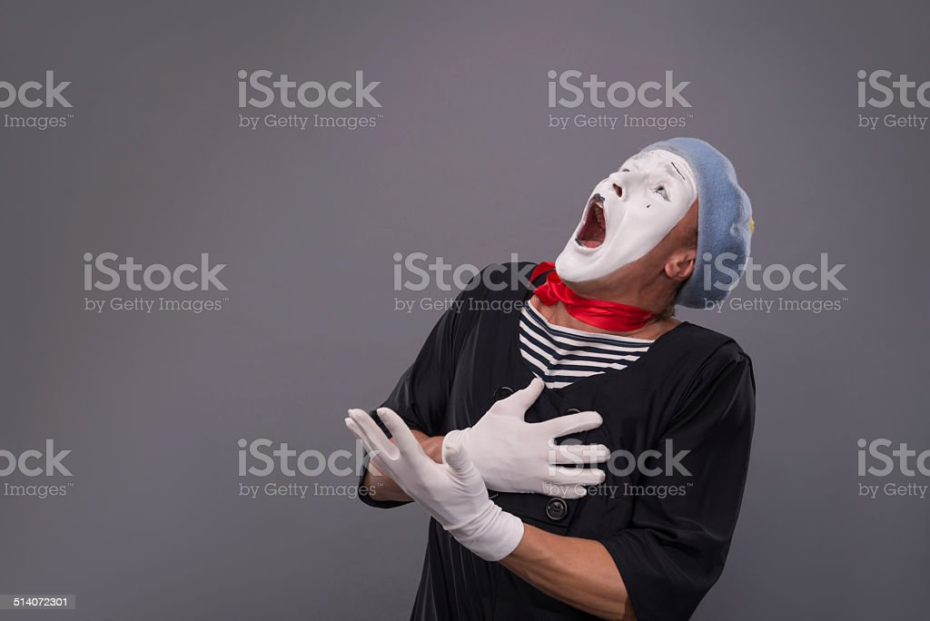 Portrait of male mime in red head and with white stock photo