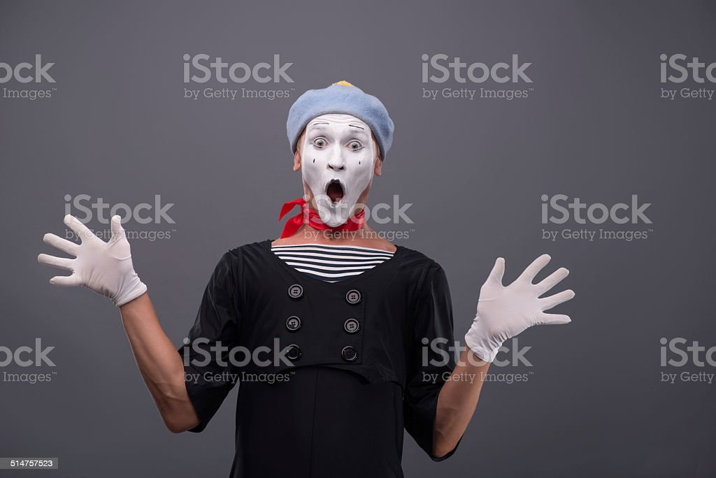 Portrait of male mime white funny face and emotions isolated stock photo