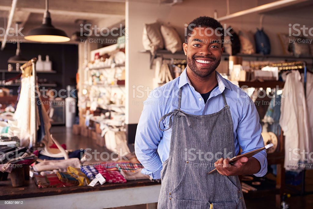 Portrait Of Male Owner Of Gift Store With Digital Tablet stock photo