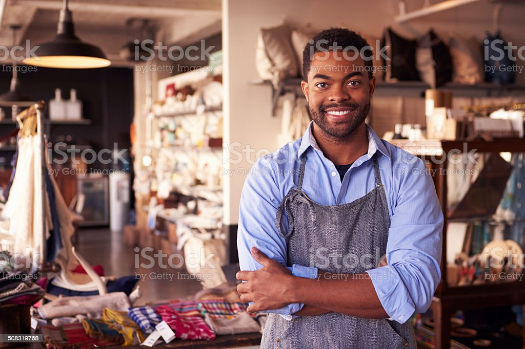Portrait Of Male Owner Standing In Gift Store stock photo