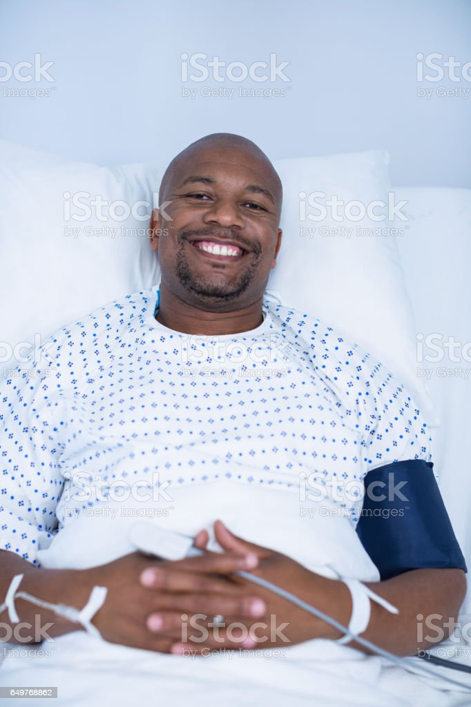 Portrait of male patient resting in ward stock photo