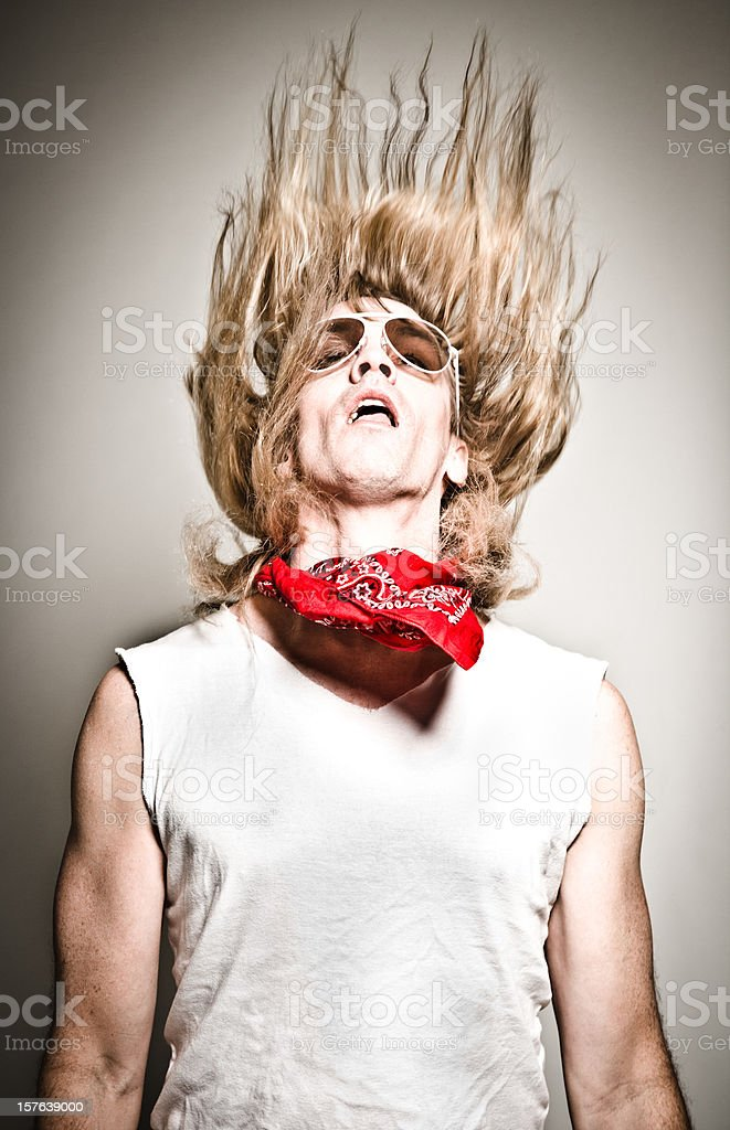 Portrait of Male Rockstar Flinging His Hair Upward. Vertical. royalty-free stock photo