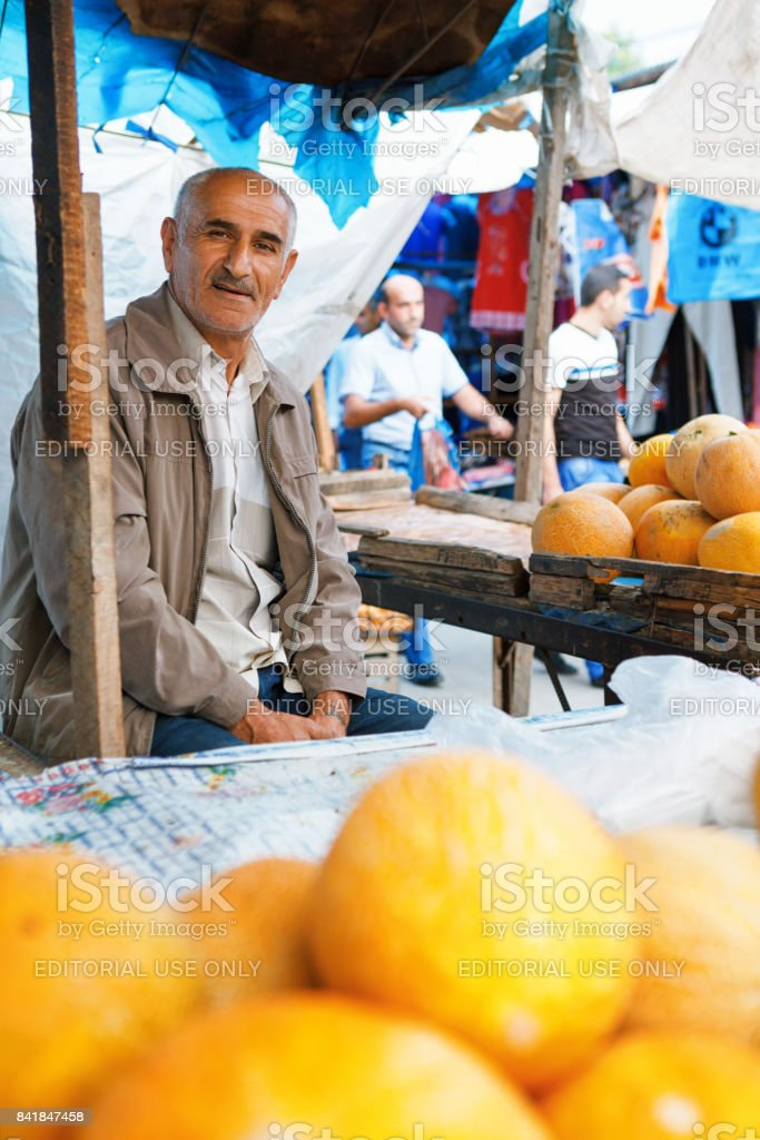 portrait of male seller fruit  looking at camera stock photo