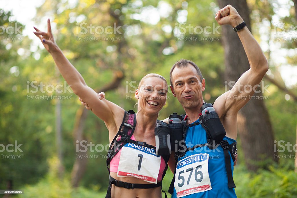 Portrait of man and woman during ultramarathon race training stock photo