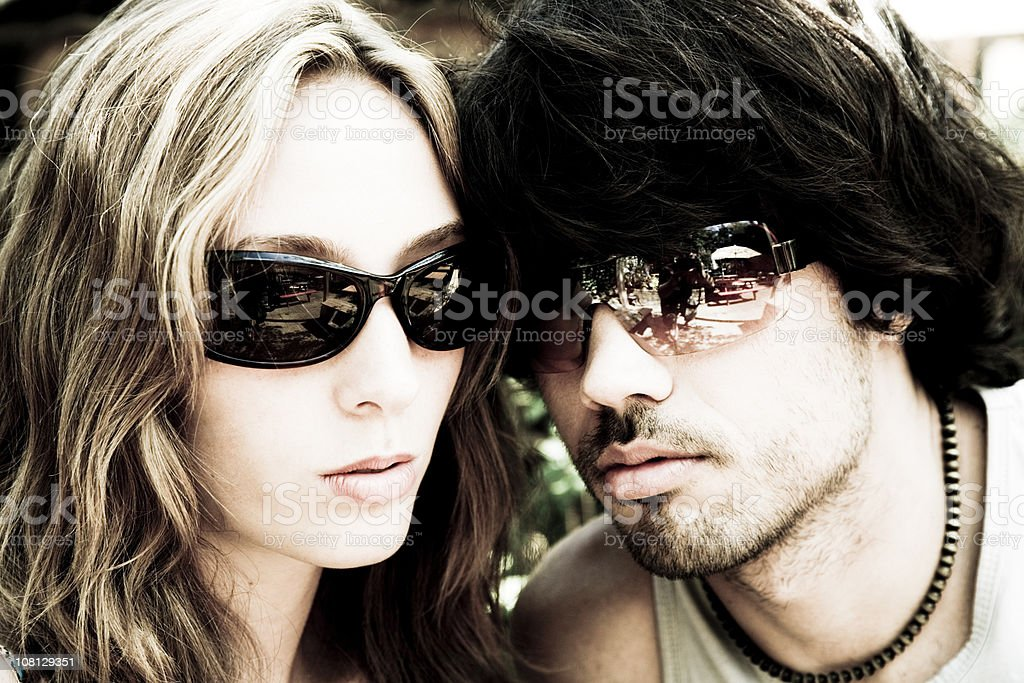 Portrait of Man and Woman Wearing Sunglasses royalty-free stock photo