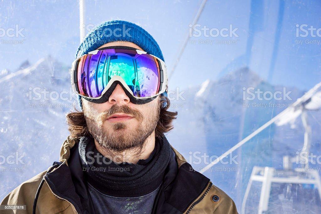 Portrait of man at ski resort stock photo