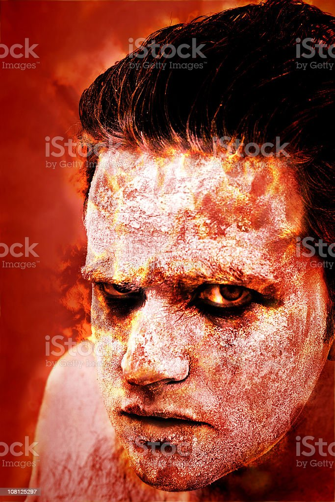Portrait of Man Dressed as Scary Demon stock photo
