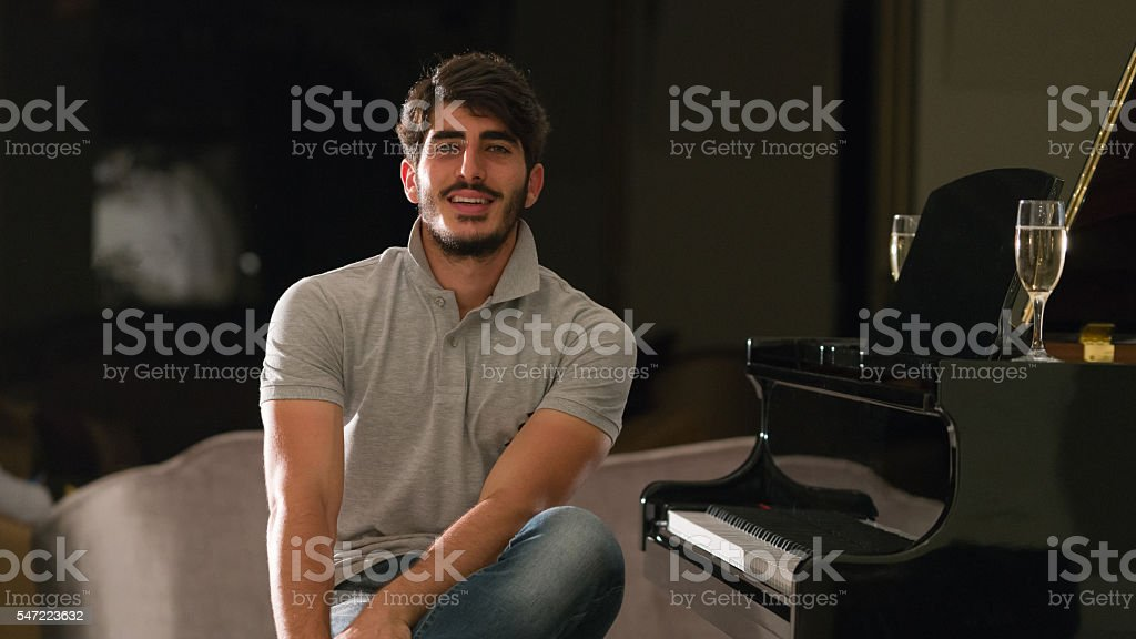 Portrait of man drinking champange in lounge stock photo
