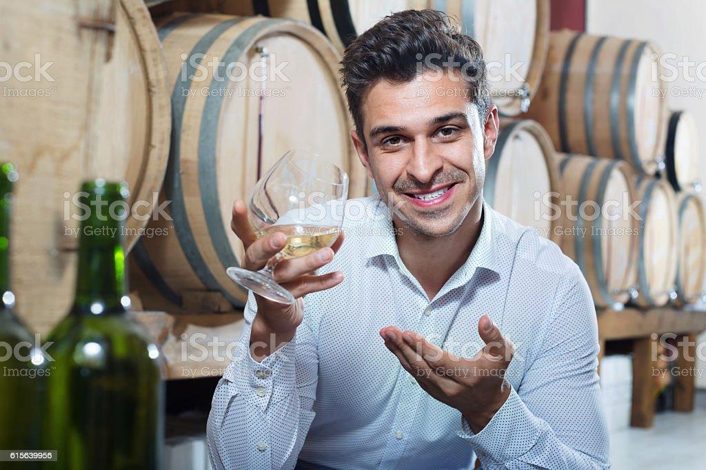 Portrait of  man enjoying liquor sample in glass stock photo
