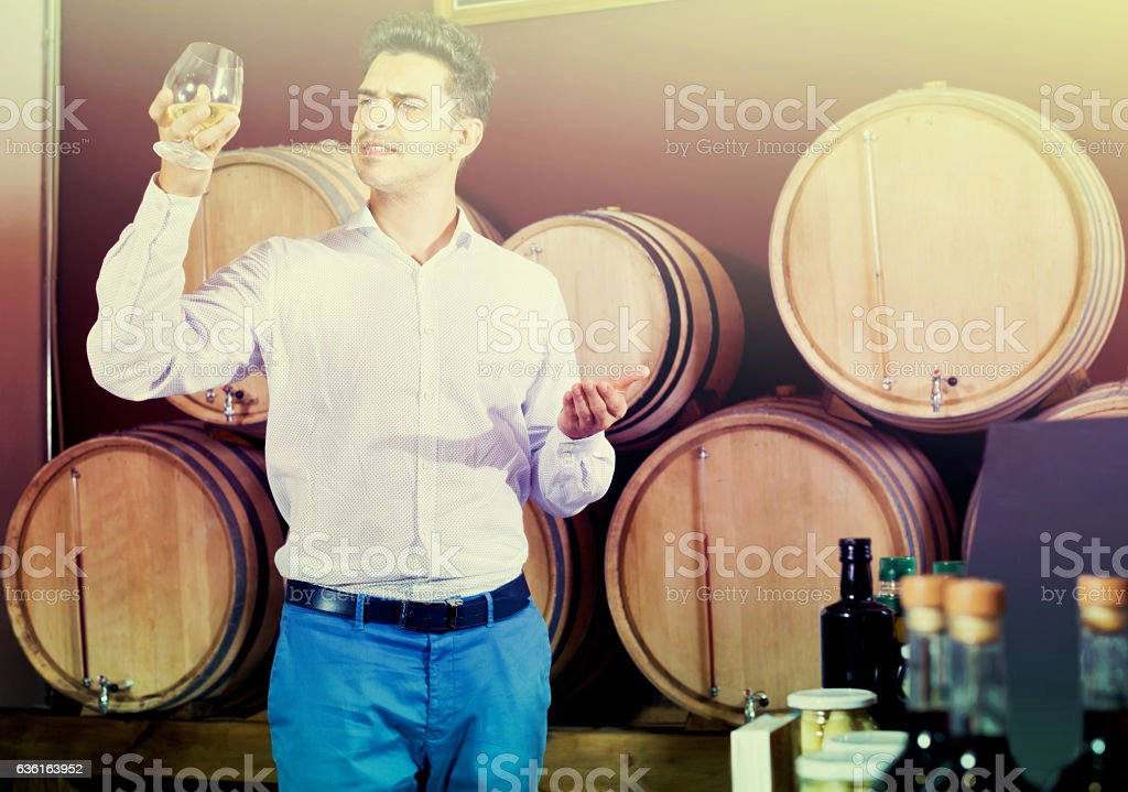Portrait of  man enjoying liquor sample in glass stock photo