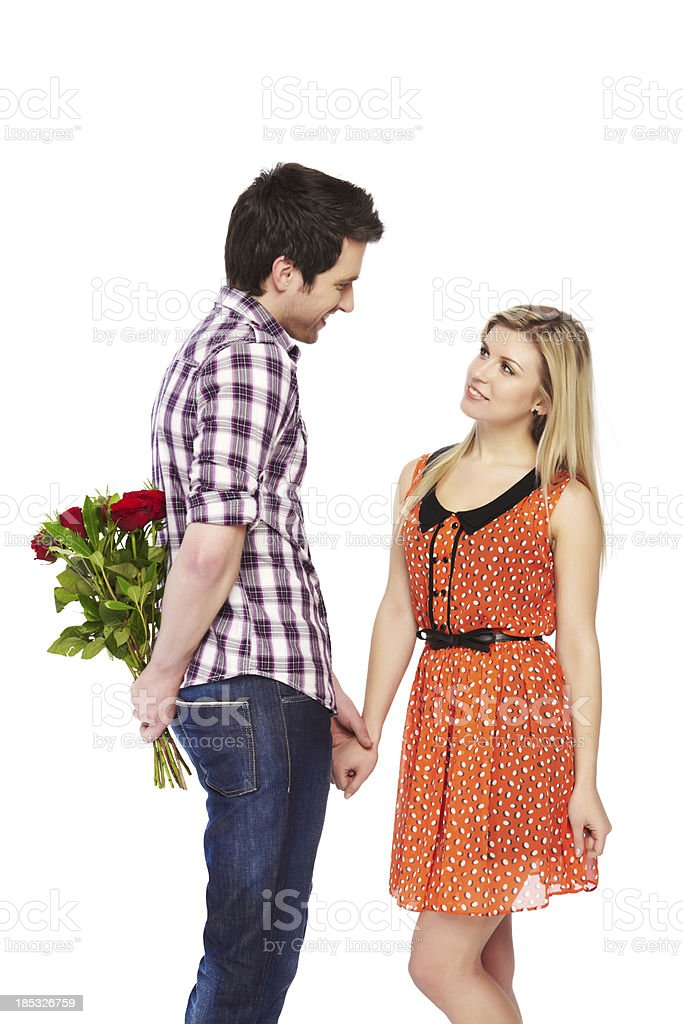 Portrait of man hiding flower to propose girlfriend royalty-free stock photo