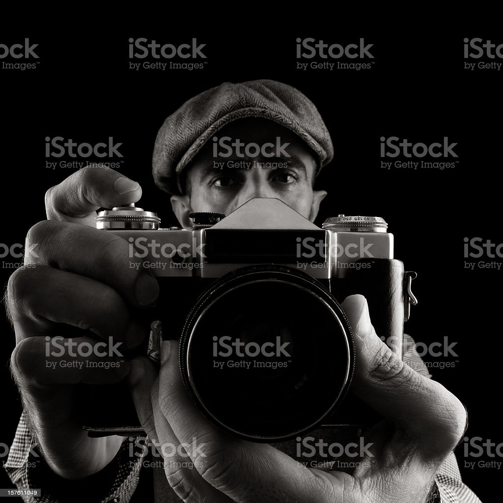 Portrait of man holding camera and taking his Self portrait stock photo