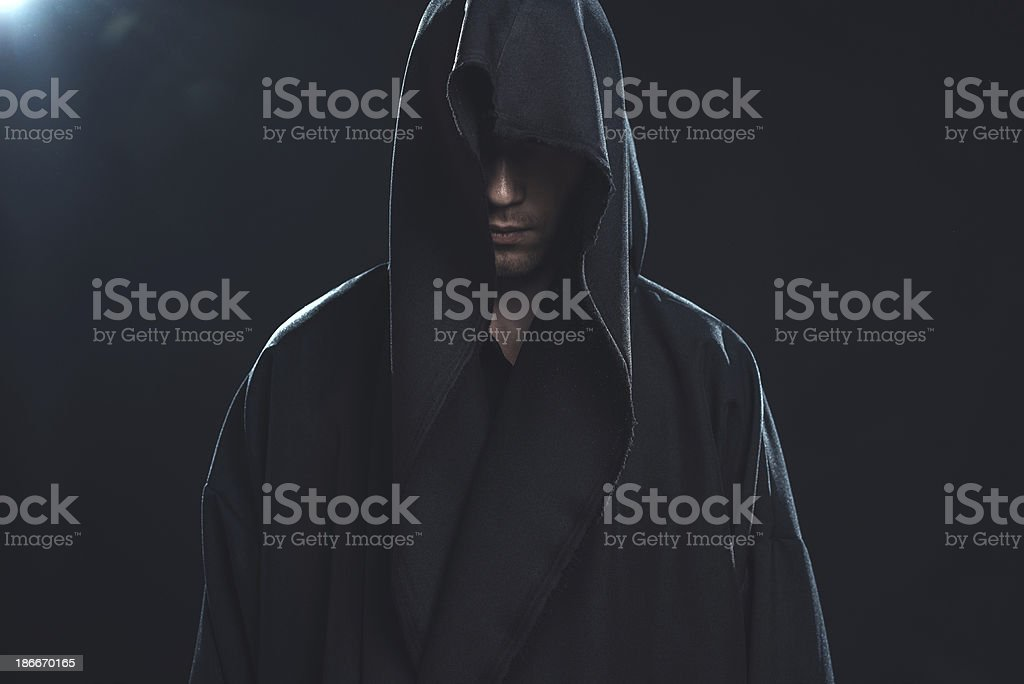 Portrait of man in a black robe stock photo