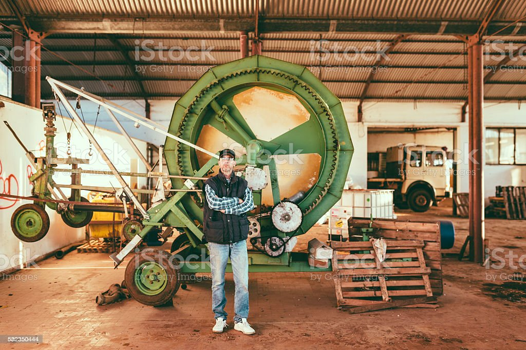 Portrait of man in agricultural shed stock photo