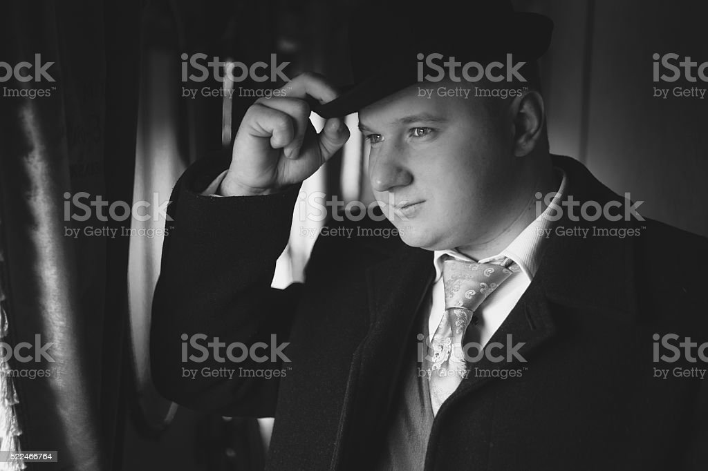 portrait of man in bowler hat looking out train stock photo