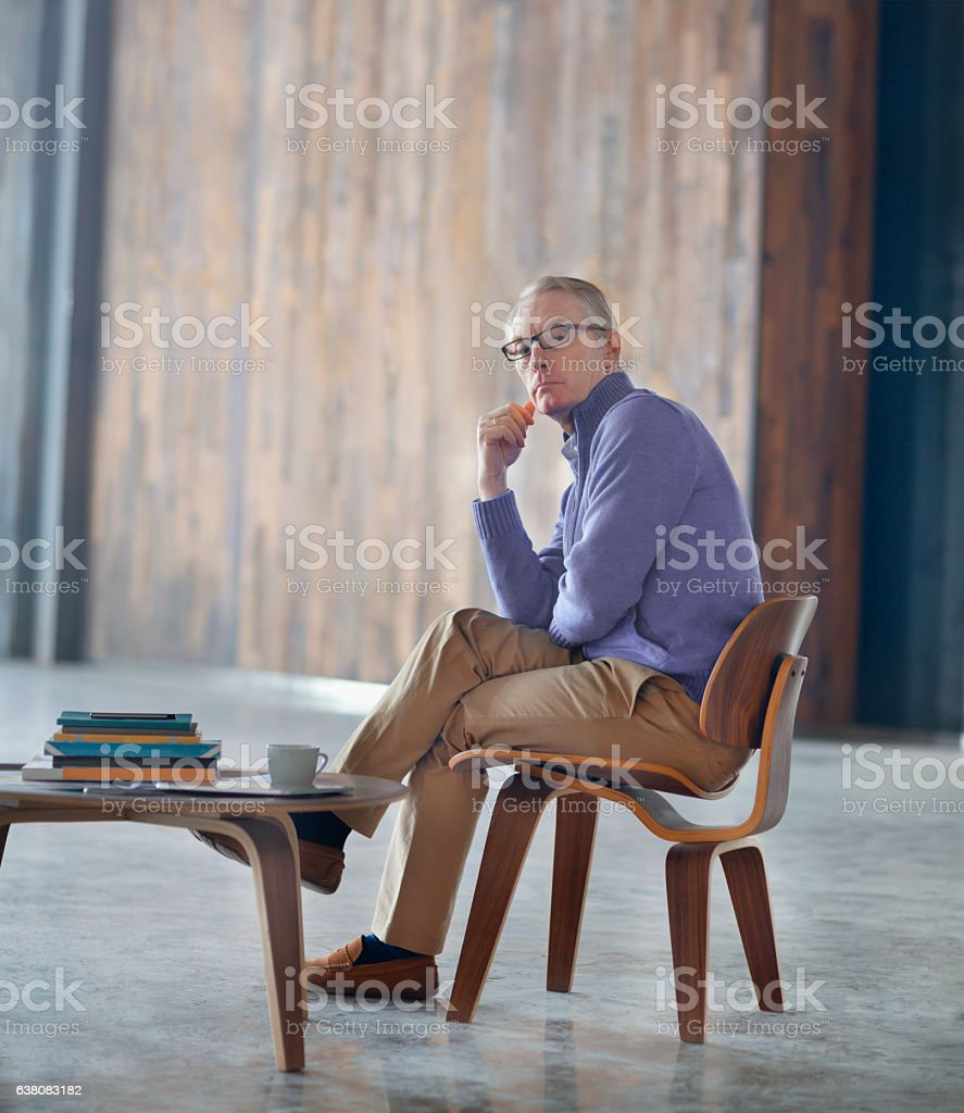 Portrait of man in large open office studio environment stock photo