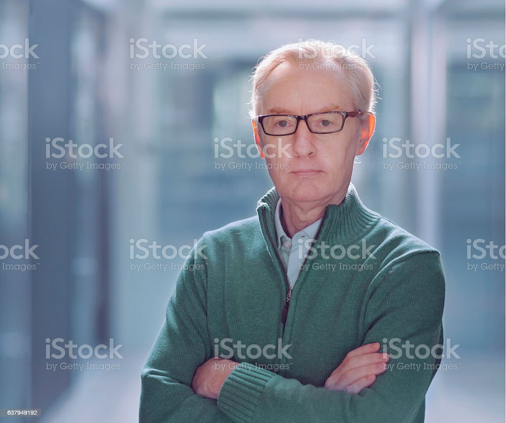 Portrait of man in modern office environment stock photo