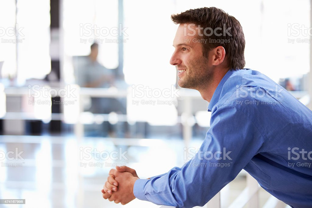 Portrait of man in office looking away from camera stock photo