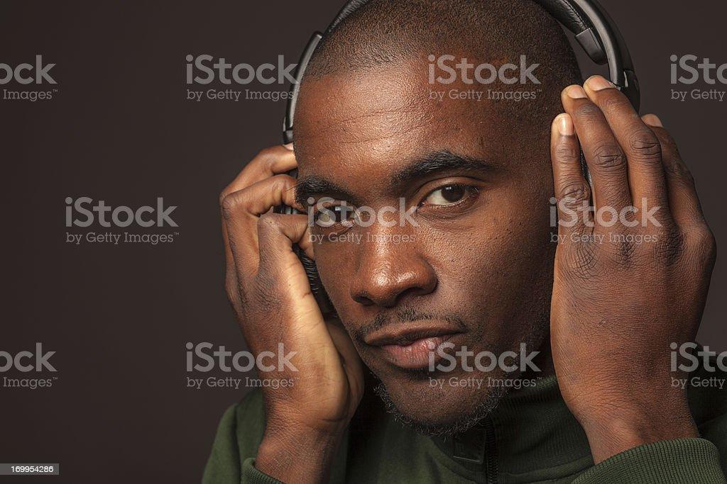 Portrait of Man Listening to Headphones stock photo