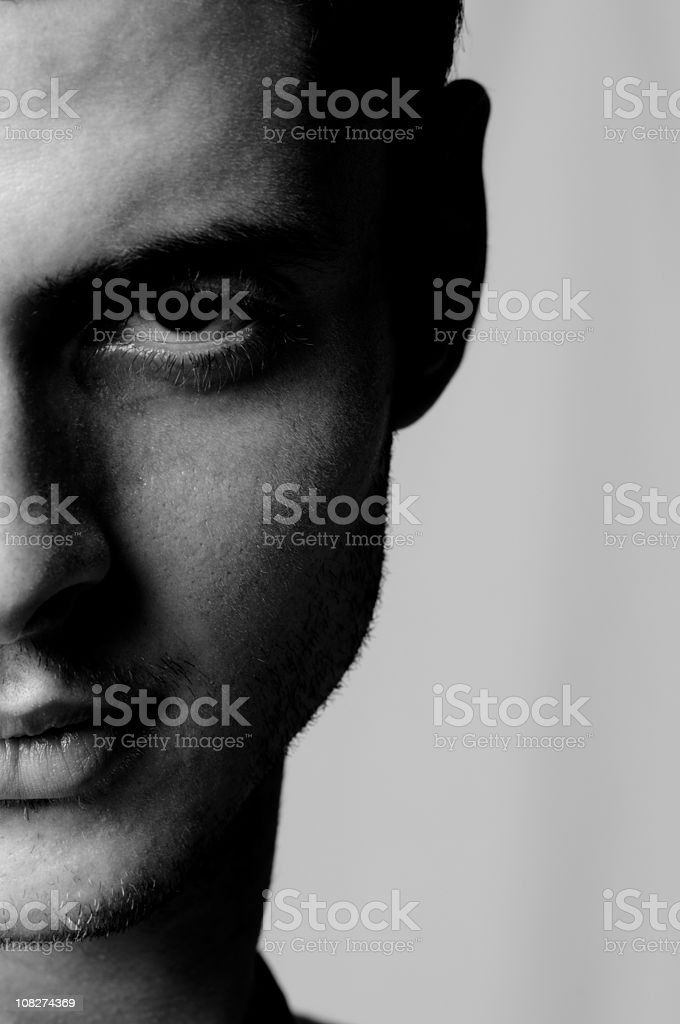Portrait of Man Making Serious Facial Expression, Black and White stock photo