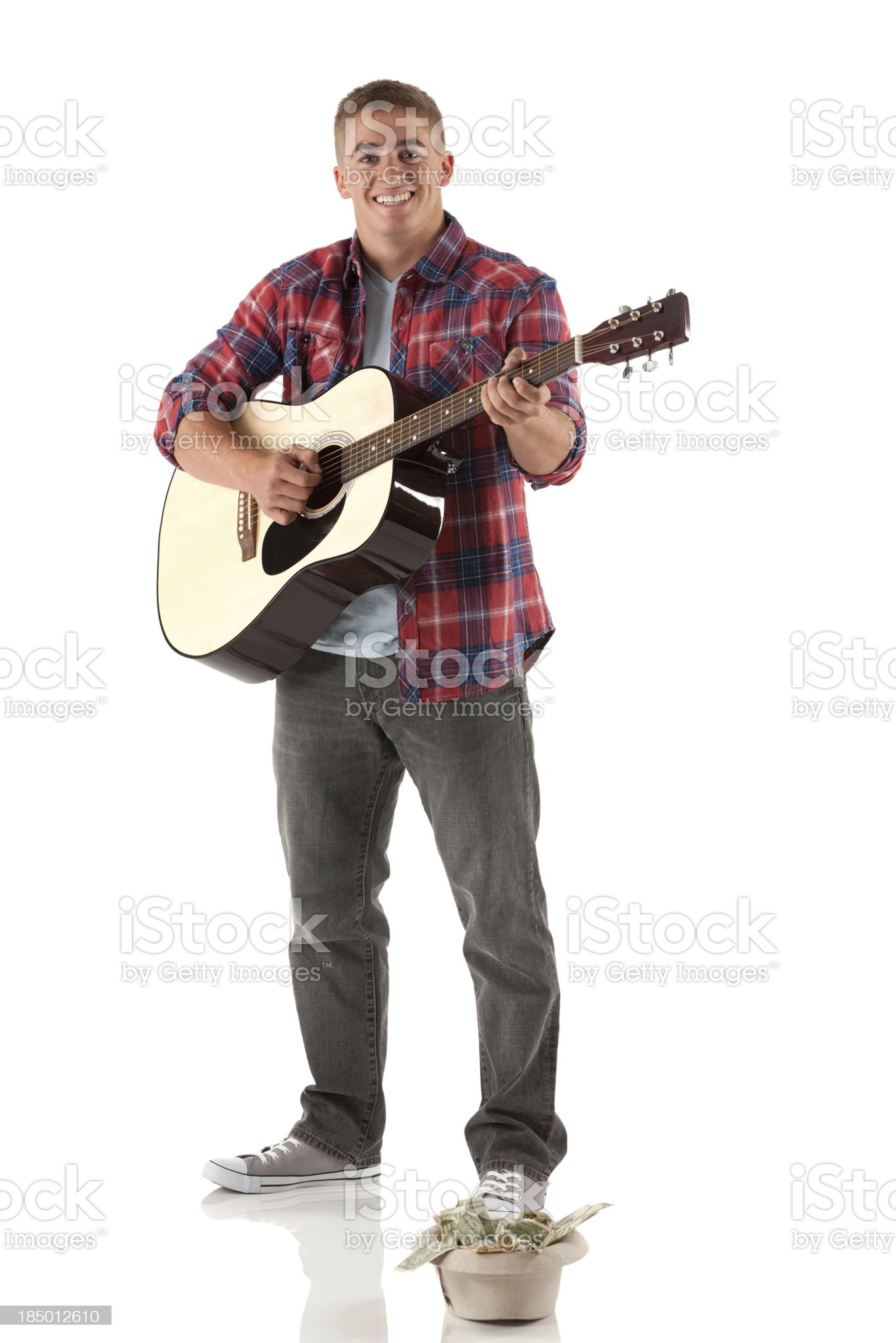 Portrait of man playing a guitar royalty-free stock photo