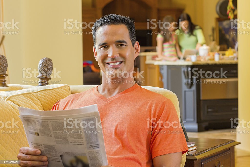 Portrait Of Man Reading Newspaper At Home royalty-free stock photo