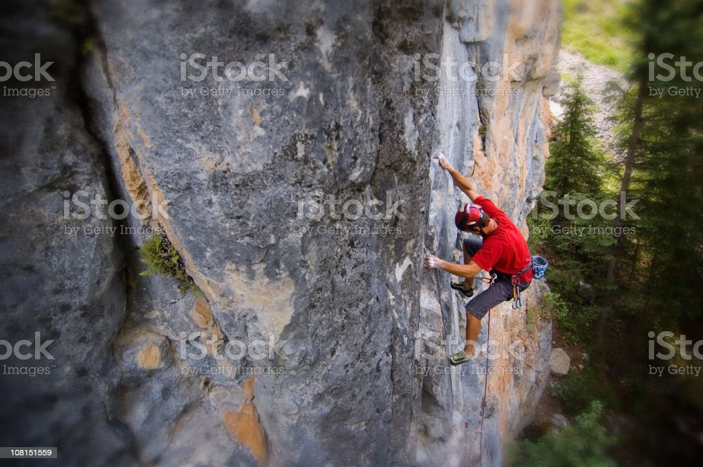 Portrait of  Man Rock Climbing Mountain Cliff stock photo