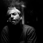 Portrait of Man Smoking Cigar, Black and White