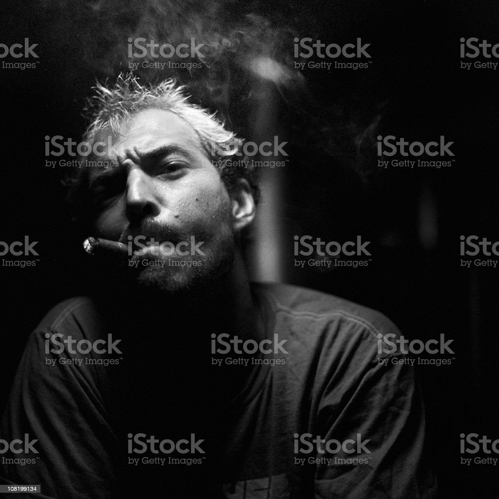Portrait of Man Smoking Cigar, Black and White royalty-free stock photo