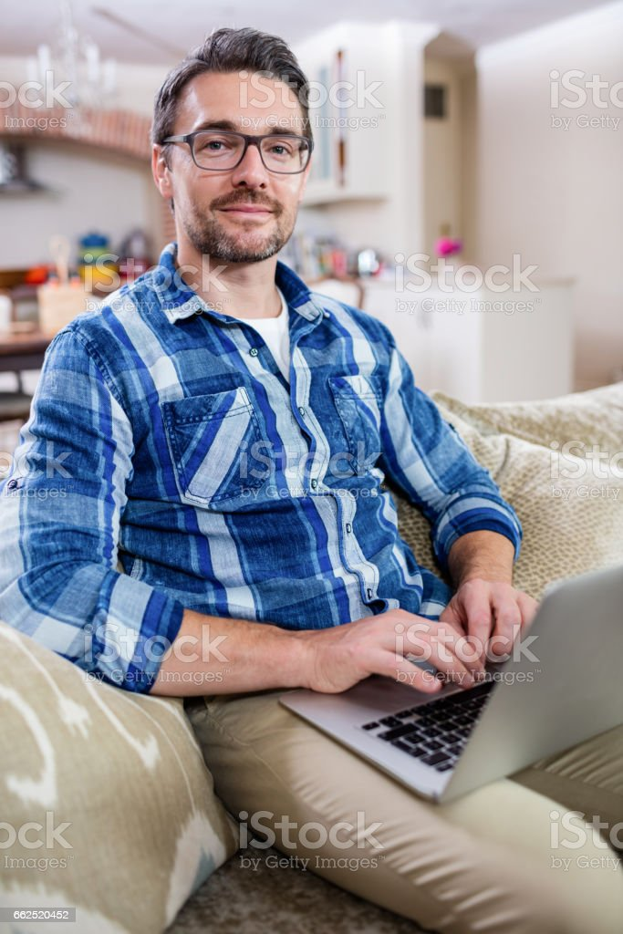 Portrait of man using a laptop stock photo