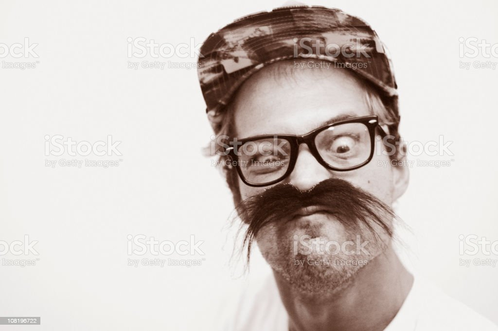 Portrait of Man Wearing Silly Mustache and Making Funny Face royalty-free stock photo