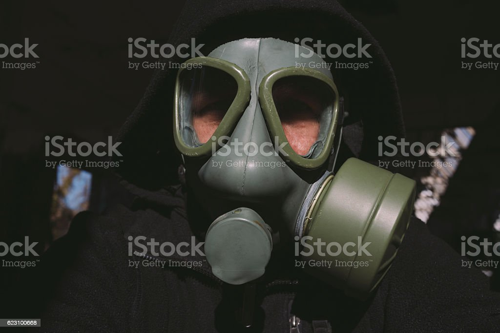 Portrait of man wearing vintage gas mask and hood stock photo