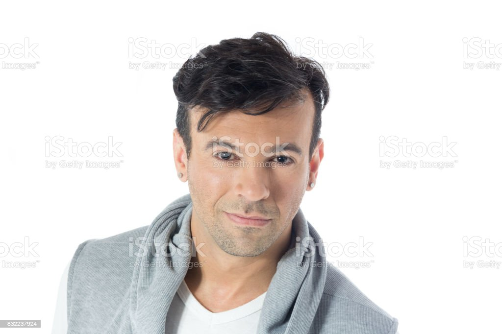Portrait of man with a slight smile. Handsome brazilian wearing gray and white clothes, neutral. stock photo