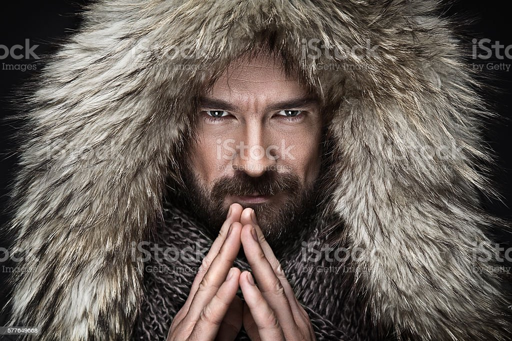 Portrait of man with beard in winter clothes stock photo